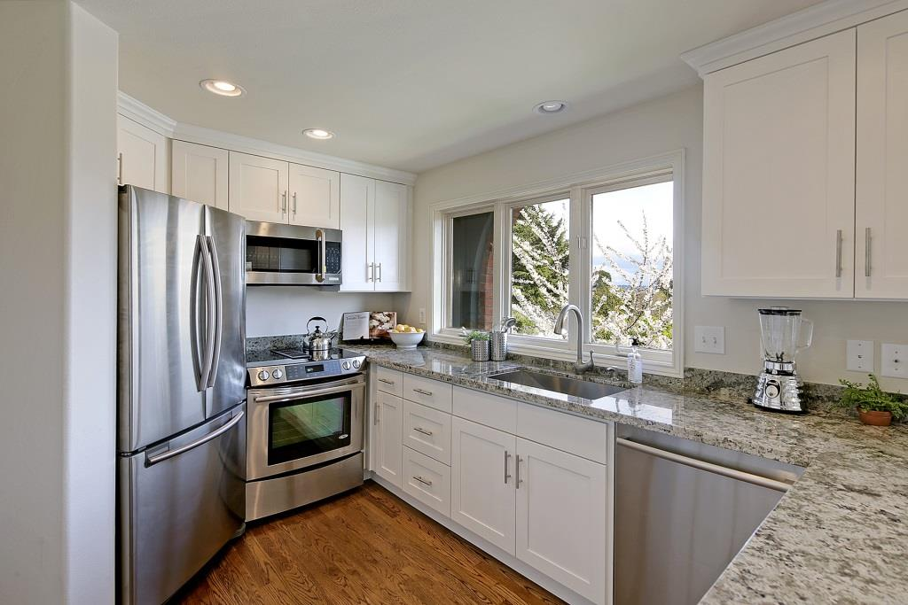 White Shaker Cabinets With Namib Green Granite Countertops