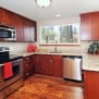Red Shaker Parawood Cabinets with Crema Persa Granite